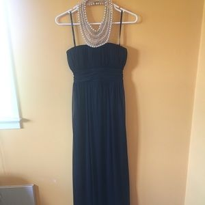Floor-length formal dress with neck detail